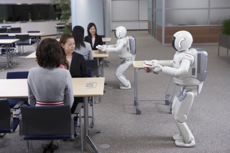 Two of Honda's Asimo Robots working together
